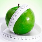apple with measure tape over fresh green gradient